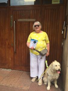 Eleanor with her guide dog and Aniridia Day leaflets